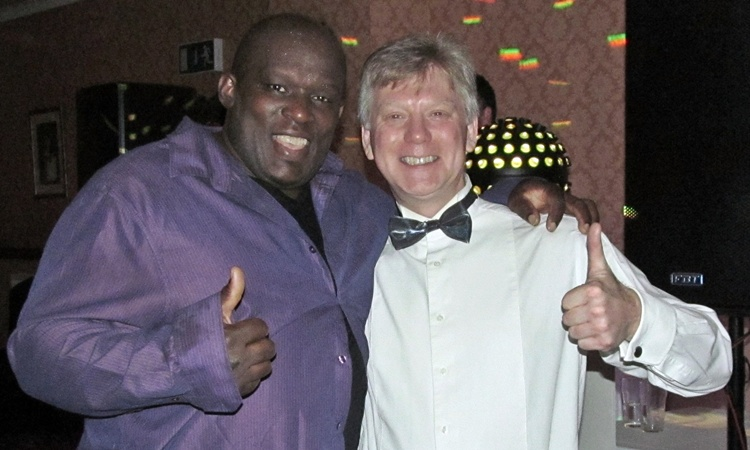 WCN Community Christmas Party - singer Ron Davis with organiser Chris Buckley.