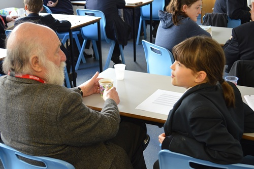 Harold Daniels chats about community with pupils at Westhoughton High School
