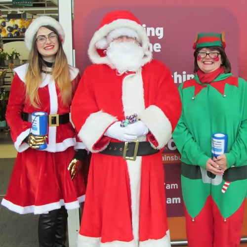 Santa helped by Mrs. Clause and Inner Wheel Elve at Sainsbury's Westhoughton