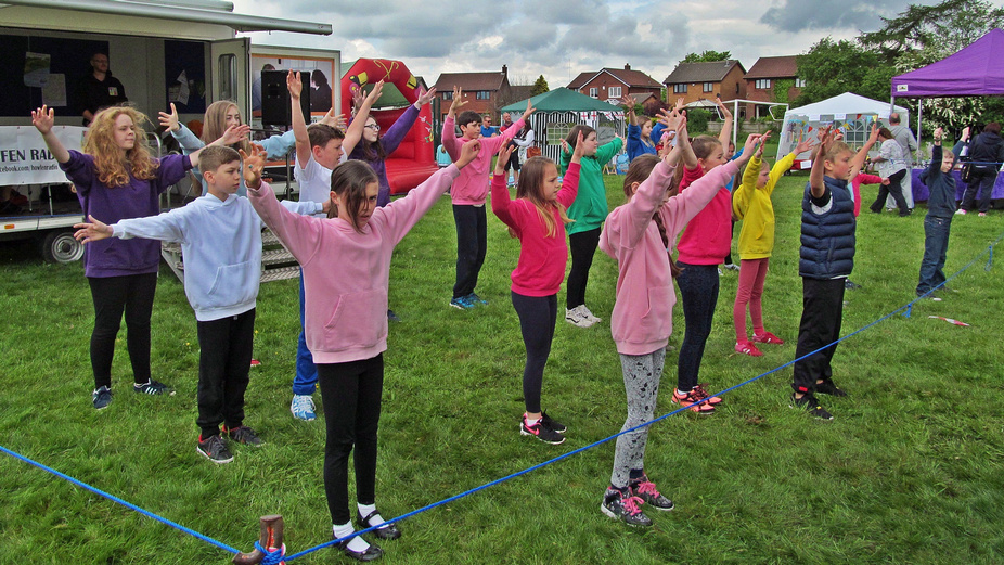 W.A.C.O It's A Knockout 2016 Westhoughton - Bethel Crowd perform as part of entertainment.