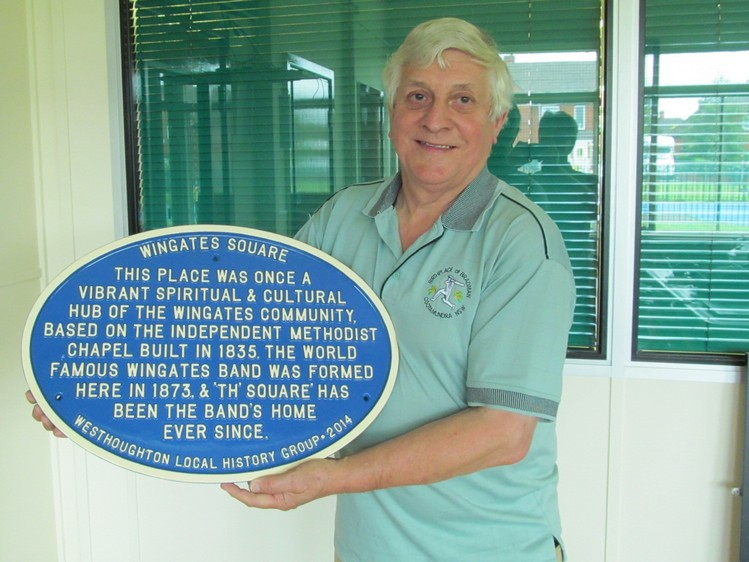 David Kaye bring the new Wingates Band street plaque to an interview on Washacre FM.