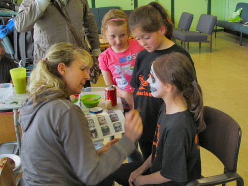 Presenter, Lisa Reilly face painting during the Showcase Day