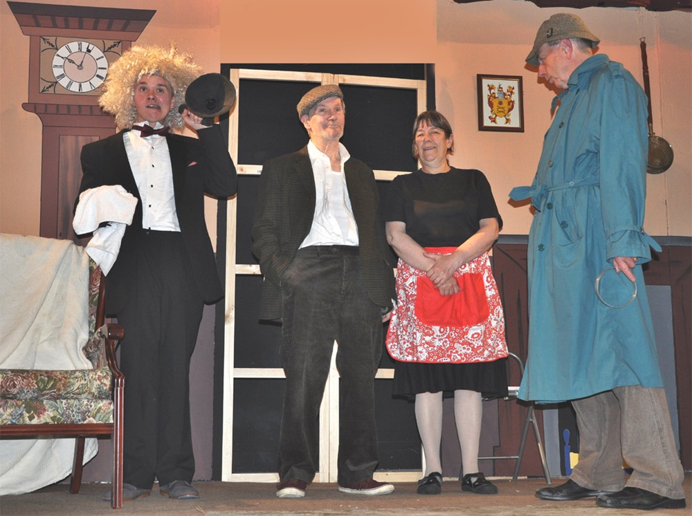Inspector Drake ruthlessly interrogates the staff of the Gagarin household.  Left to right:  Mr Guest (the butler), Mr Cook (the gardner), Mrs Gardner (the cook) and Inspector Drake.