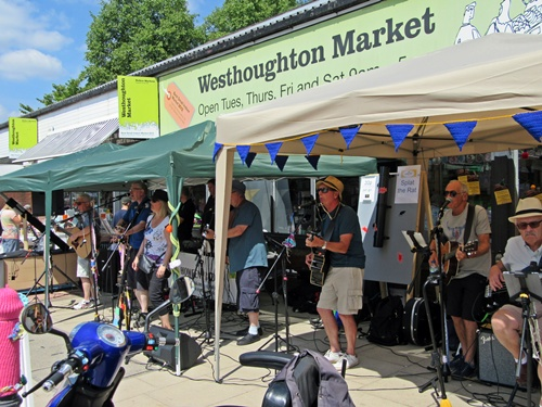Westhoughton Yarn Bombing Festival 14th / 15th July 2018 - Travellin' Strings performing outside market